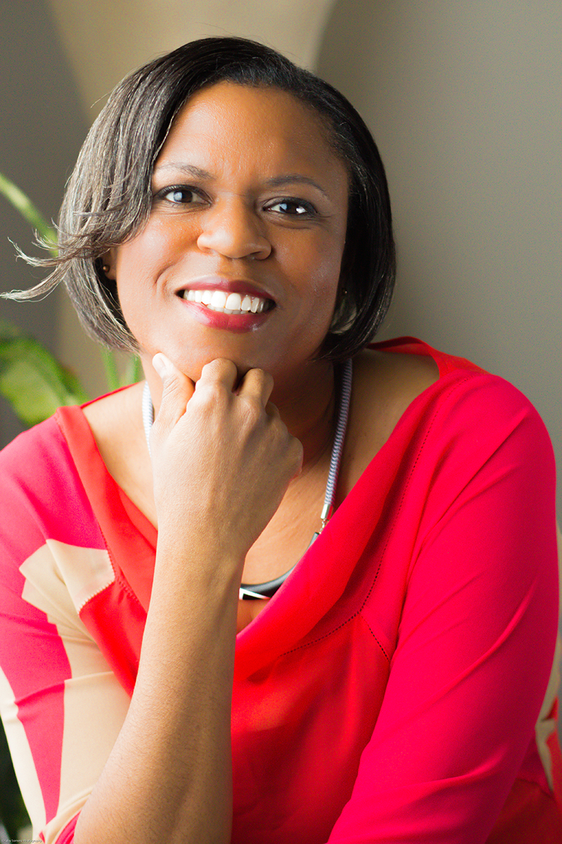 Black female wearing a red shirt