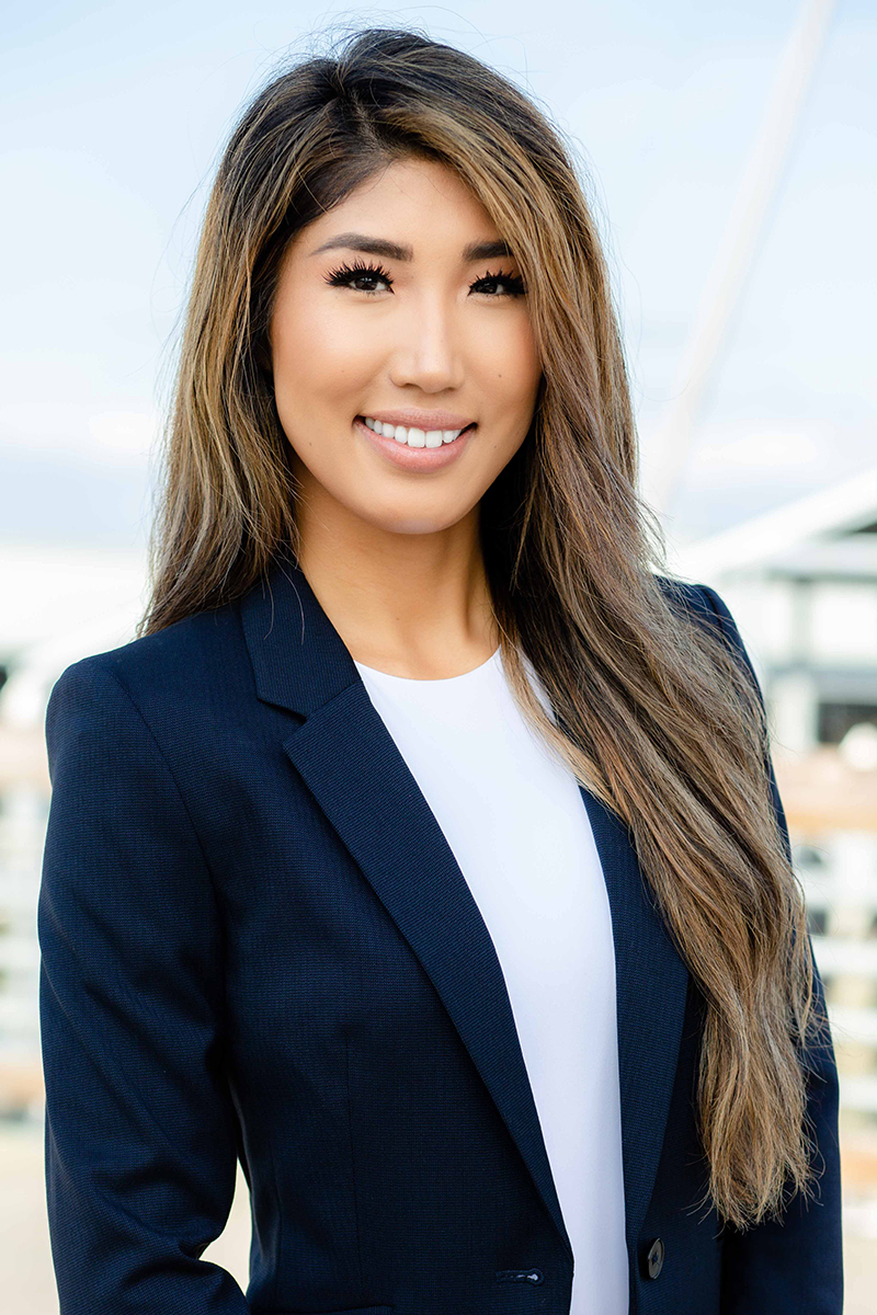 Asian Female wearing a navy blazer and white shirt