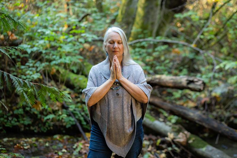 Spiritual Caucasian woman in the woods